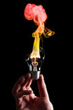 Bulb and fire Stock Photos