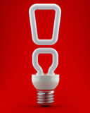 Bulb in the form of a exclamation mark Stock Photo