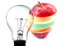 Bulb and fruit Royalty Free Stock Photos