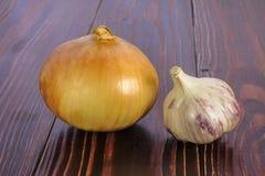 Bulb and garlic head Royalty Free Stock Photography