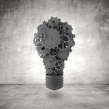 Bulb with gears and cogs Royalty Free Stock Photography