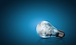 Bulb with gears Stock Image