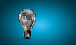 Bulb with gears stock images