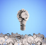 Bulb with gears Royalty Free Stock Photography