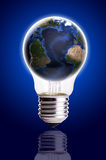 Bulb with globe blue black gradient background,Earth Map and Globe shape courtesy of NASA. Stock Photos