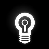 Bulb glowing icon. Light bulb icon with search sign on black background Stock Photo