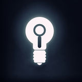 Bulb glowing icon. Light bulb icon with search sign on black background Royalty Free Stock Image