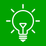 Bulb on green background Royalty Free Stock Image