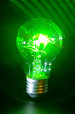 Bulb green power. Concept of classic bulb green power light with laser rays royalty free stock image