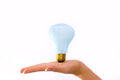 Bulb on a hand. Photo of light bulb on a hand royalty free stock photo