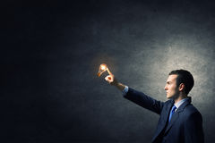 Bulb in hand Stock Photography