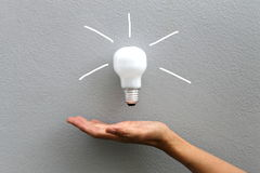 Bulb and hand Royalty Free Stock Image