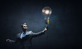 Bulb in hand Royalty Free Stock Photography