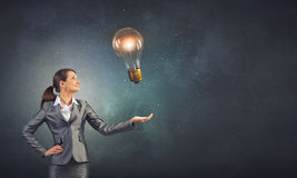 Bulb in hand Royalty Free Stock Photo
