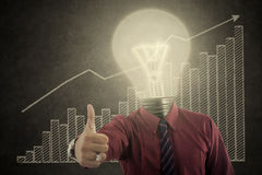 Bulb head businessman showing thumb up. With growing graph Stock Photos