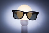 Bulb Head. A light bulb wearing Sunglasses Royalty Free Stock Photos