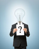 Bulb headed business man with question mark Stock Images