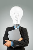 Bulb headed man and laptop Stock Photos