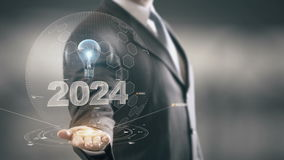 2024 with bulb hologram businessman concept stock footage