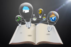 Bulb idea. Over an open book royalty free stock photo
