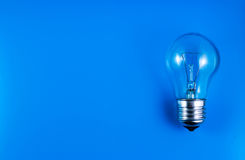 Bulb idea on blue background acid Royalty Free Stock Images