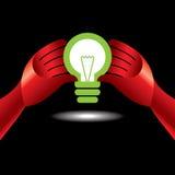 Bulb idea with human hand Stock Image