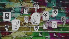 The idea in questions. Bulb with the idea and interrogative signs of different designs stock video footage