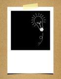 Bulb idea photo paper on board background.  Stock Illustration