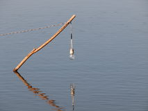 Bulb lamp hanging over water surface in a fish farm Stock Image