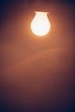Bulb lamp warm light in fog Royalty Free Stock Photos