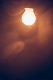 Bulb lamp warm light in smoke Royalty Free Stock Photography