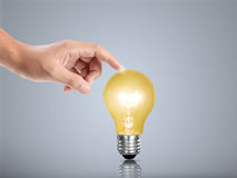 Bulb light in a hand Royalty Free Stock Image