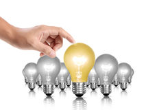 Bulb light in a hand Royalty Free Stock Photo
