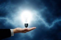 Bulb light in hand, man. Bulb light in hand, man on blue background stock image