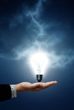 Bulb Light hanging on business woman Stock Photography