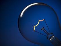 Bulb Light Over Blue Royalty Free Stock Photos