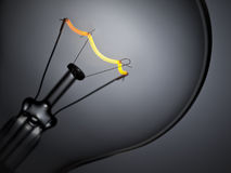 Bulb light over grey Royalty Free Stock Photos