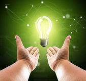 Bulb light on two hand of man Royalty Free Stock Images
