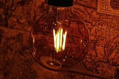 Bulb lighting on map Royalty Free Stock Photography