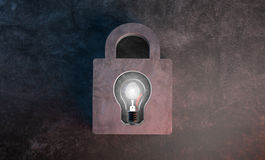 Bulb lights, Copyright protect and lock creative idea. Bulb lights, Copyright protect and lock fingerprint Identification of creative idea Royalty Free Stock Images