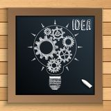 Bulb mechanism with cogs and gears written by chalk on blackboard Stock Images