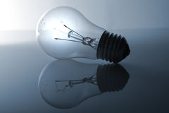 Bulb on/off. A bulb and its reflection. The bulb is switched on but the reflection is switched off Stock Photo