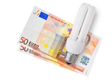 Bulb over euro bills Royalty Free Stock Photo