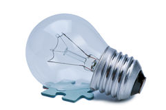 Bulb and puzzle. Royalty Free Stock Image