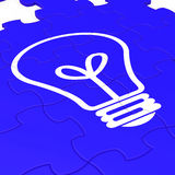 Bulb Puzzle Shows Intelligence And Inventions Royalty Free Stock Images