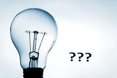 Bulb and question mark Stock Images