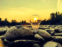 Bulb. River sunset sky rocks Stock Photo