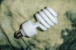 Bulb on rough denim Stock Photo
