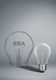 Bulb with shadow idea on grey, creative concep Stock Images