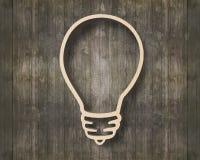 Bulb shape bookshelf on wooden wall Royalty Free Stock Photography